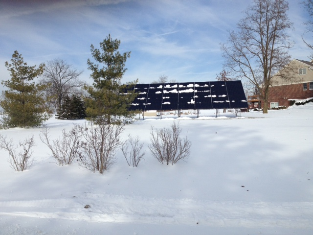 Snow Covered Solar Array At 40 Degree Angle
